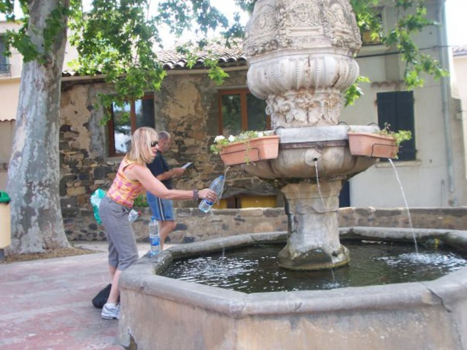 Getting our crystal clear water from the Village Fountain