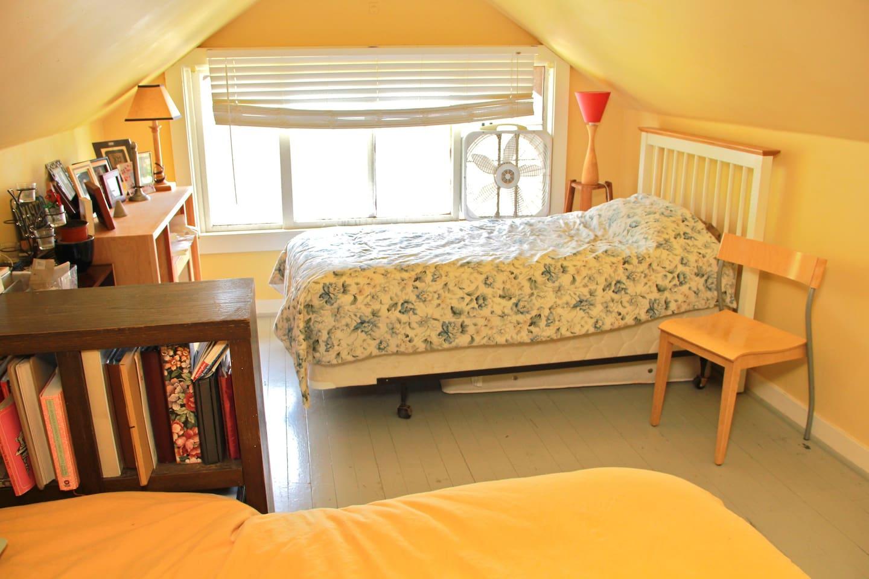 Twin Bed near west window