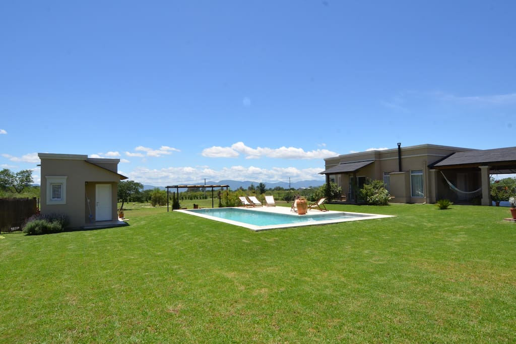 Large garden and swimming pool to relax and enjoy the sun