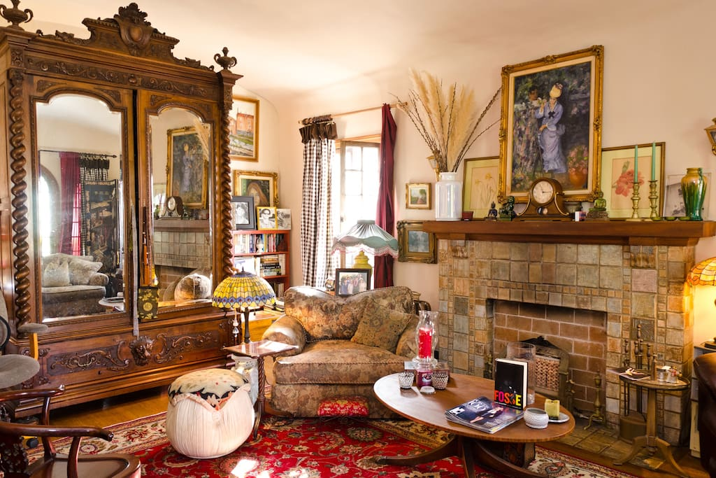 Living room, barrell ceiling, antique armoire, Batchelder fireplace