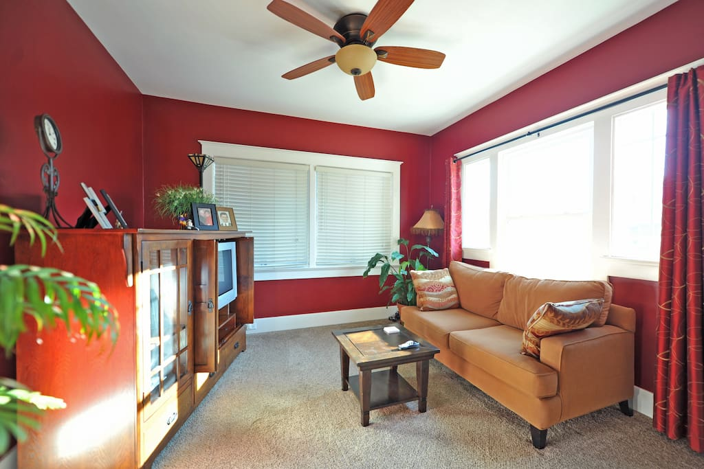 This TV room/den is adjacent to the living room and is specifically for guest use.