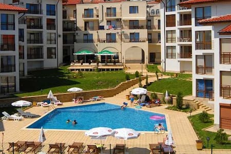 A lovely, 1-bedroom holiday apt (sleeping up to 4, with bed+sofa) in small & quiet 'Compass' complex. It's just 200m from beach & part of the Dinevi Resort - so you have access to all pools & restaurants - so lots of variety on your doorstep for all!