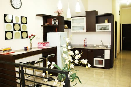 Get special price for more than a month occupancy!  Apartment on the 1st floor with well-equipped private kitchen and private bathroom.  Kindly read the house rules carefully.