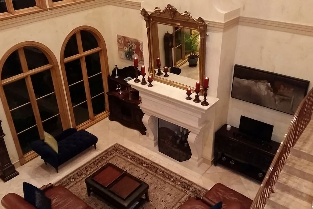 View of living room from second floor landing