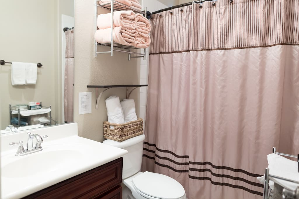 Your private bathroom with plenty of fresh towels, soaps, lotion, tissues, cotton swabs, and a hair dryer