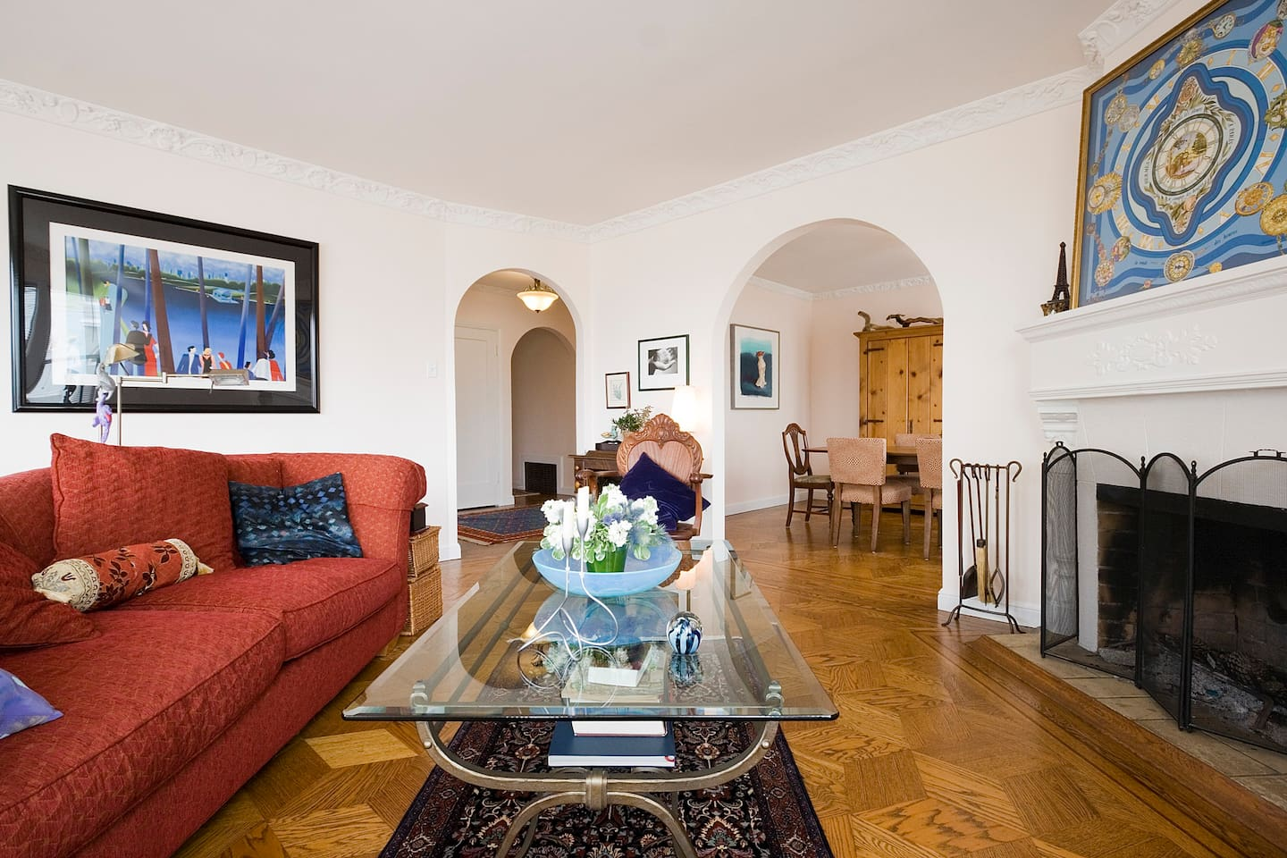 Le Salon:  relax in the  living room, with a view of the dining room and foyer