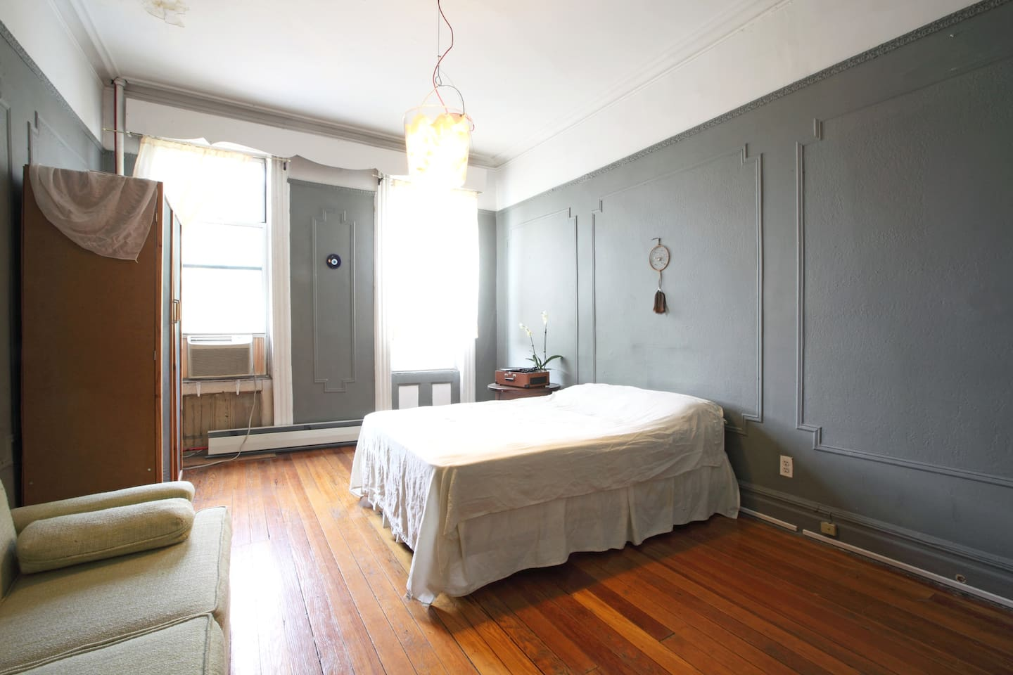 Bedroom:: full sized bed, air conditioner, 7 foot couch & standing closet