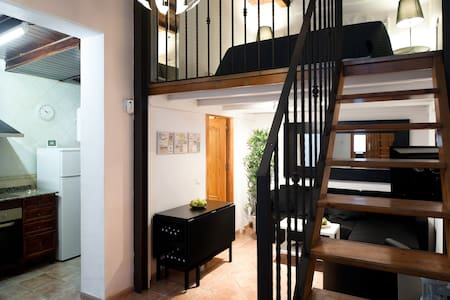 Cozy two-story loft in one of the most familiar and best located neighborhood in Barcelona. Very close of two subway stations.