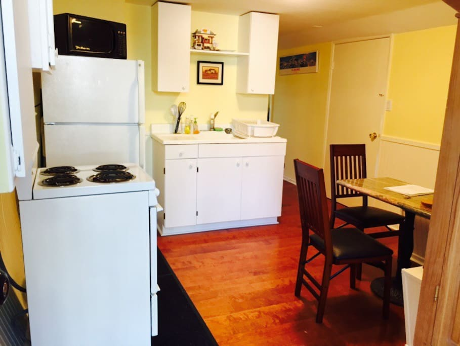 Full fully stocked kitchen with stove and refrigerator. Tea and coffee.