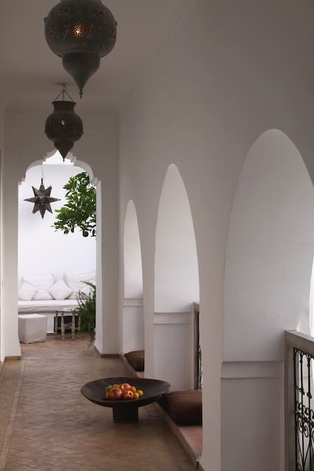 The 1001 Nights room is at the end of an open corridor, on a lovely  patio