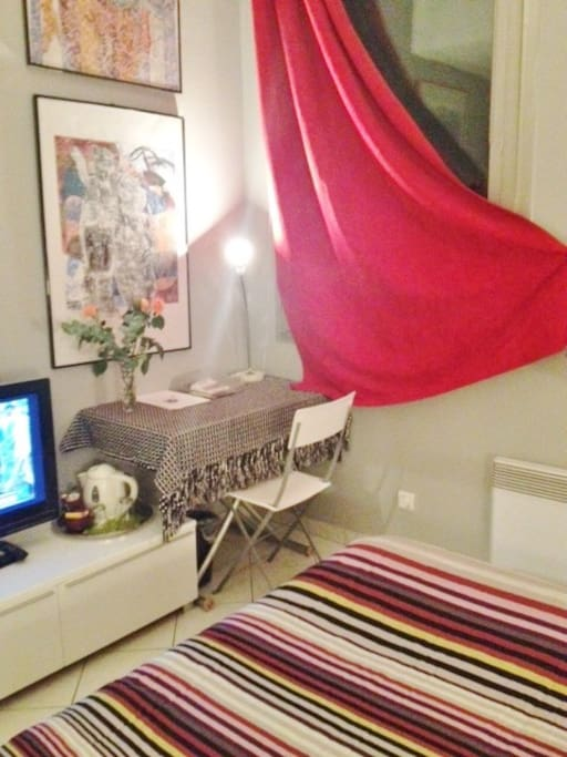 Your room with table, kettle and tv