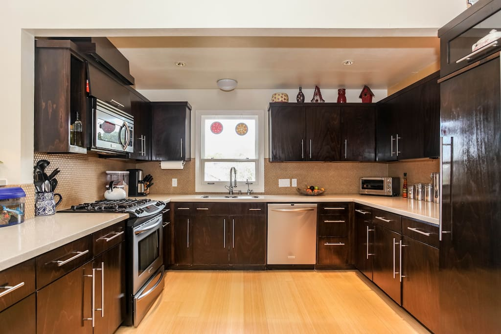 A modern kitchen with stainless steel appliances and custom cabinetry.