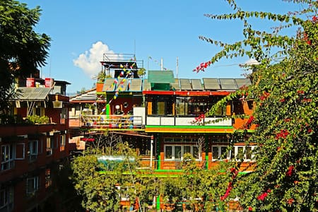 Shangri-La Boutique Hotel.We are located two minutes away Thamel Center. It is very peaceful and nice for out doors. You see Royal Palace, Architecture Monarchy, Nice Mountain view from the top of the hotel, Roof top access, and etc. We provide reasonable price with great customer service.