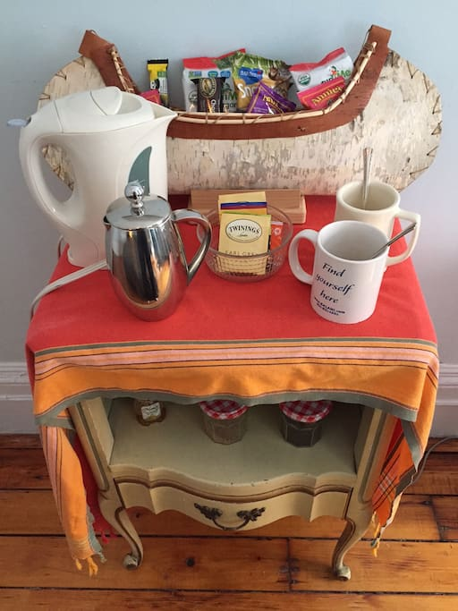 Snacks, tea, and coffee in your room.