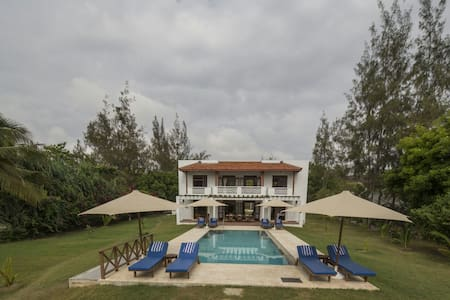 Villa fronting sandy beach