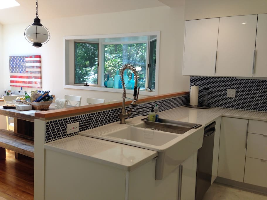 Our kitchen was renovated in 2014 with new cabinets, quartz countertops, marble floors and brand new stainless steel appliances. Our East Hampton Welcome Basket in the background!