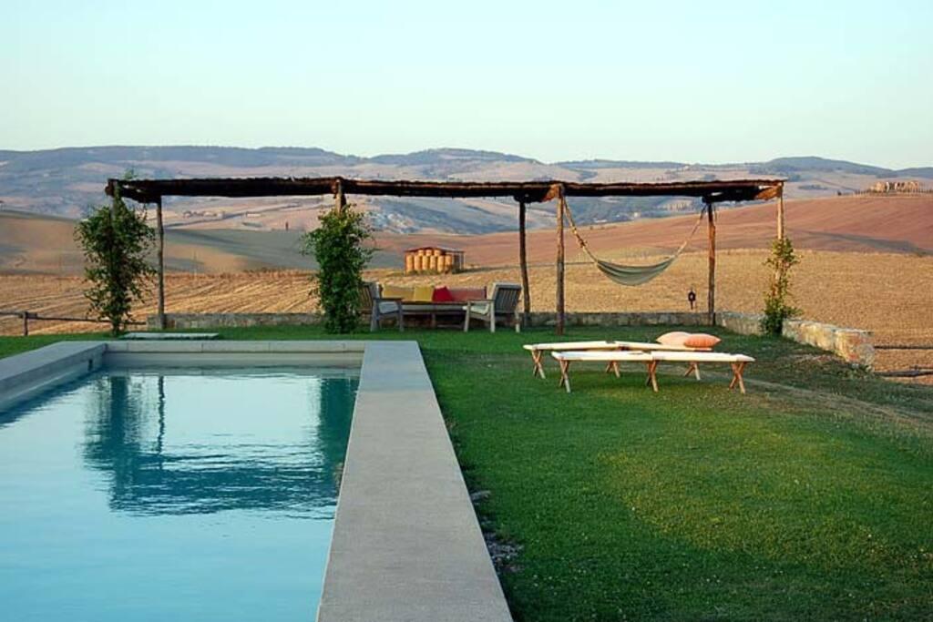 Swimming pool with pergola