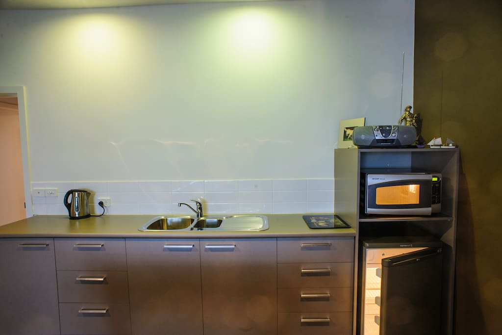 Kitchenette has refrigerator, microwave, kettle and toaster