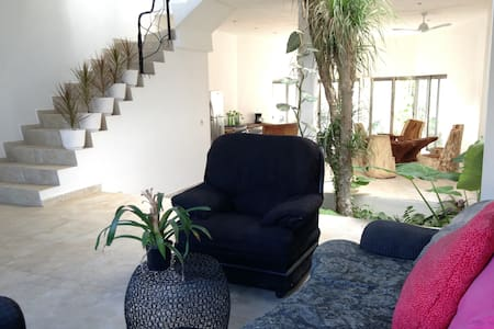 A beatiful new house in Puerto Morelos. Two big bedroom, 2 bathrooms, fully equipped, very confortable, partial ocean view. Just 50 meters from the most beatiful beach in town. Three blocks from downtown