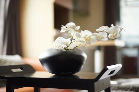 """S Studio is nice, cozy and friendly place near Daan MRT. We name this room-Delight (喜樂), that means """"inner peace and Zen way of being"""". Decorated by black&white, wood&stone and unadorned elegant furniture, it will comfort your trip like you're home."""