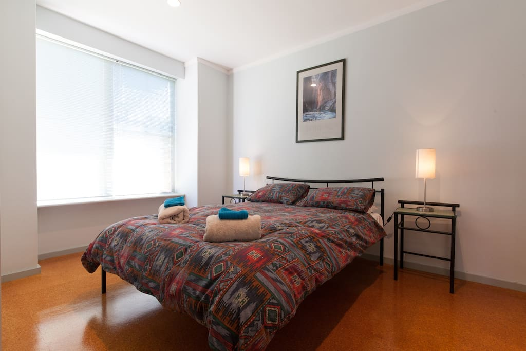 Large separate bedroom wth kingsize bed and plenty of natural light