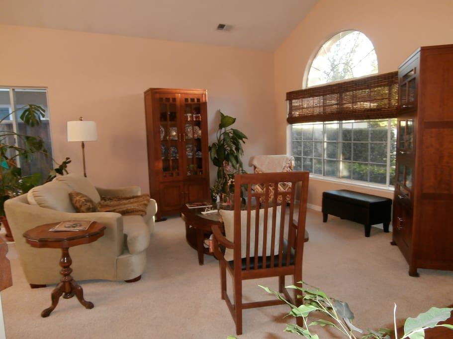 Cozy living room with abundance of sunlight.