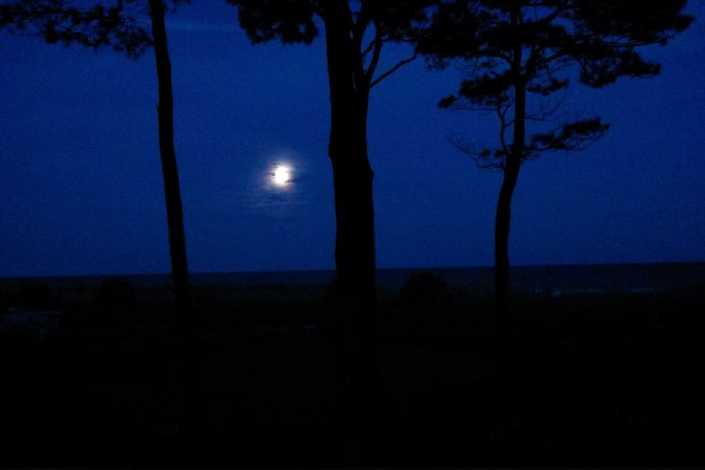 Full moon over the ocean from the private balcony