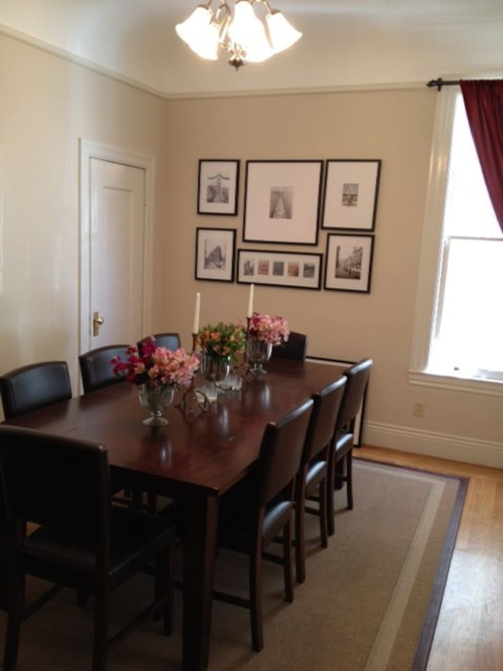 Stylish dining room with eight person dining table.