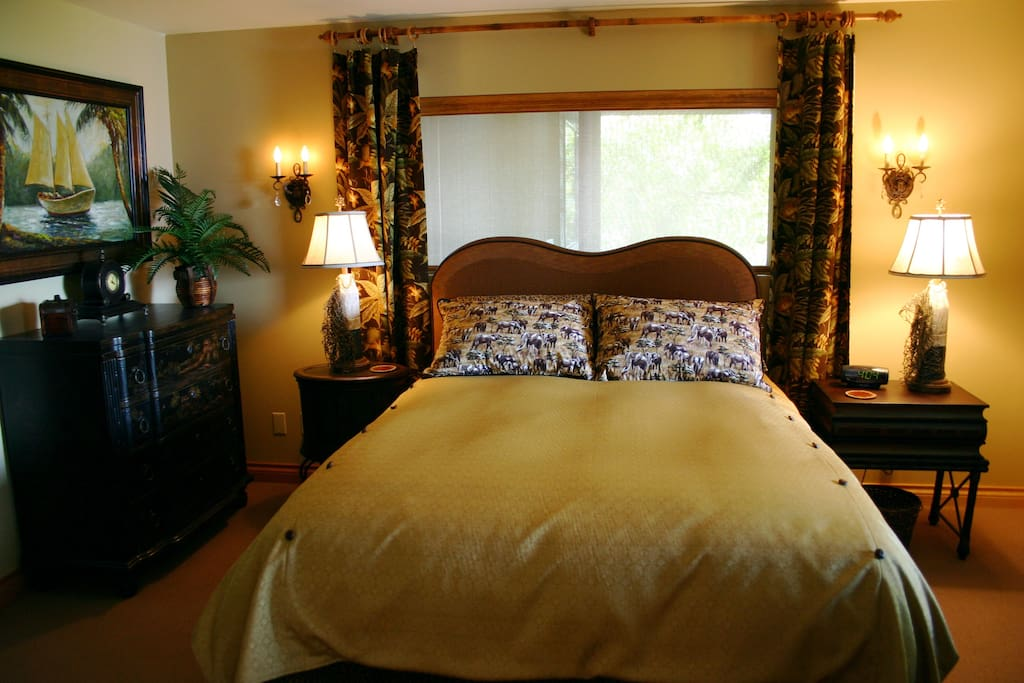 Luxurious bedroom with two, large oceanfront windows, separate from living area with pocket doors