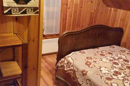 Cozy bedroom at Chalet Lou Pitchoun - Huis