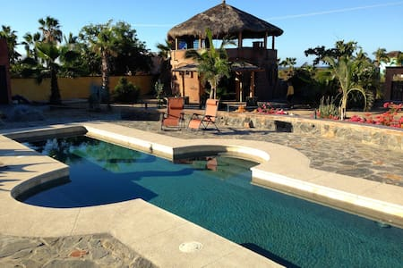 Enjoy living inside a seaside jewel, swimming in a stunning 45-ft. pool, watching golden sunrises and spectacular sunsets from the gorgeous upstairs palapa, with an uncrowded beach just steps away.  Close to Cerritos Beach and charming Todos Santos.