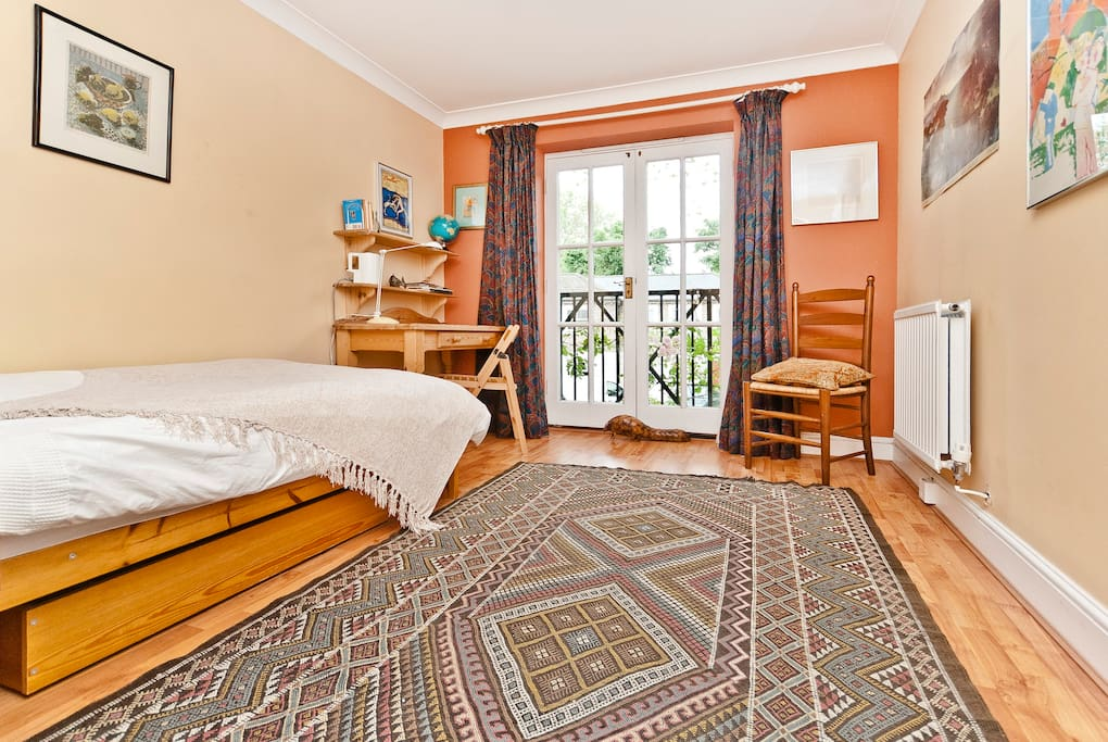 Airy room, south facing with French windows overlooking front garden