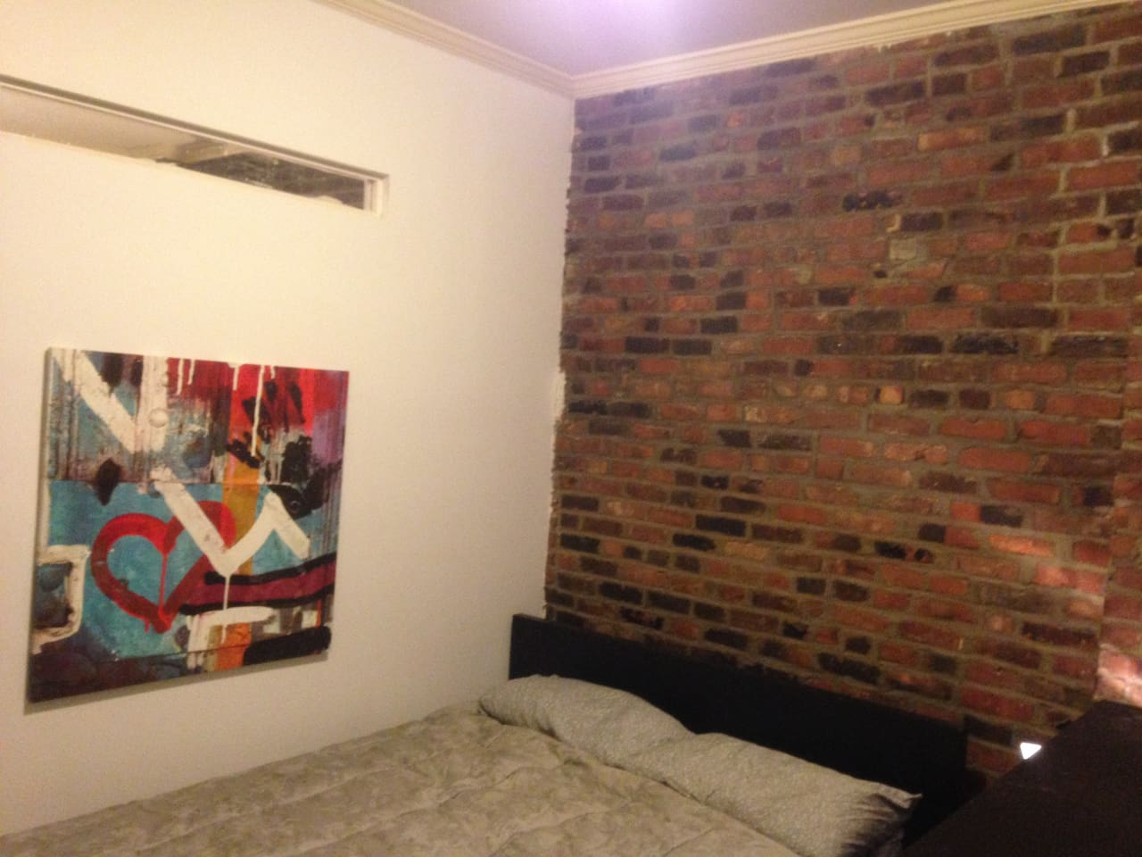 Exposed brick, spacious room with queen bed