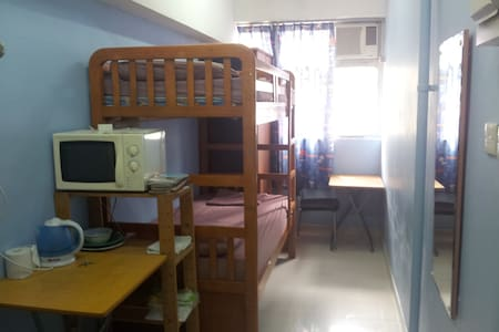 Convenient Studio, second floor apartment in an awesome location.   Furnished with 1 Bunk bed, can sleep 2 persons. Linen provided.  Equipped WiFi, TV, Air-Conditioning, Oven Microwave,  Refrigerator, Kettle. Private shower room.