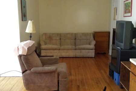 Large main room with full kitchen and eating alcove, double bed-couch, TV and chair.  Full bath.  Walk in closet. In a national historic neighborhood in Detroit - West Village - 3 miles to downtown. Enter at downstairs door and greet Lexie the cat