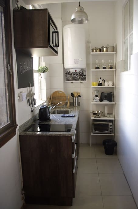 Small but fully equipped kitchen for cooking any meal. Microwave, small electric oven, kitchen utensils, etc.