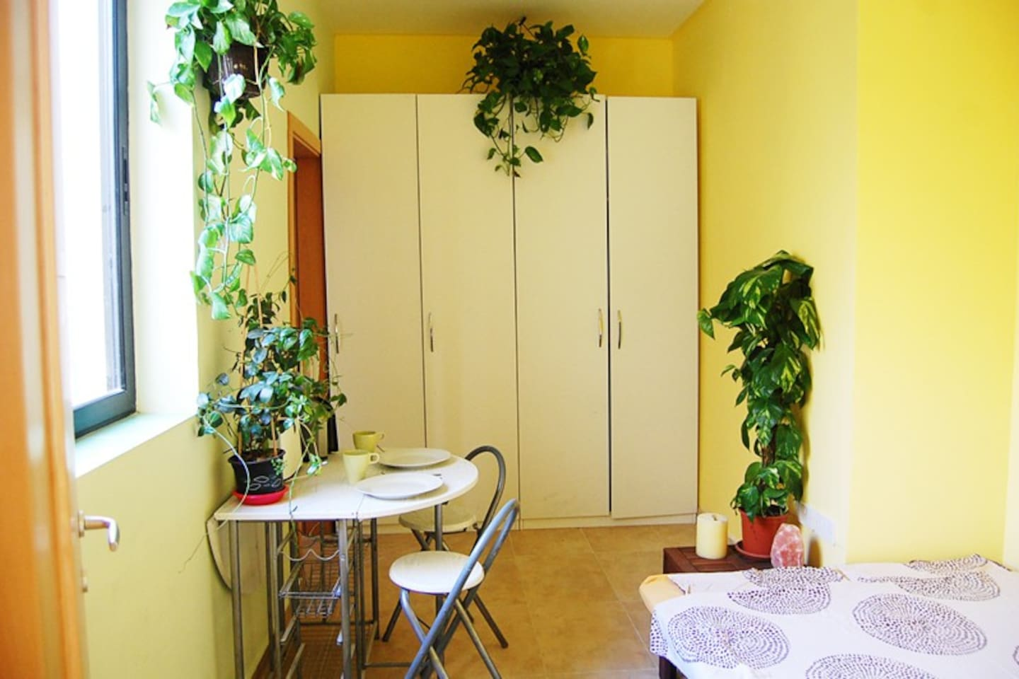 Your bright en-suite double-bedroom with yellow walls, free Wi-Fi, a big window facing to the inner yard which makes the room very quiet. Walls are painted yellow to activate your 3rd chakra (solar plexus), which  is responsible for self-esteem. A couple