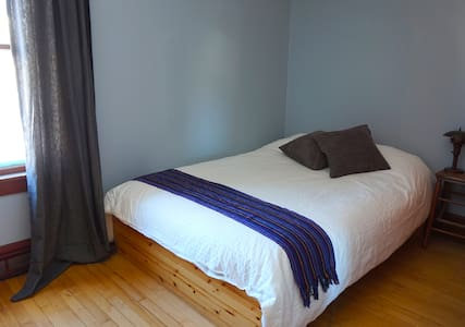 Our cozy home is a short walk to downtown. Your room has a private, updated bathroom and we always stock our favorite local organic coffee and lots of tea. We know the area well, and have a canoe, yoga mats and a hammock to share!