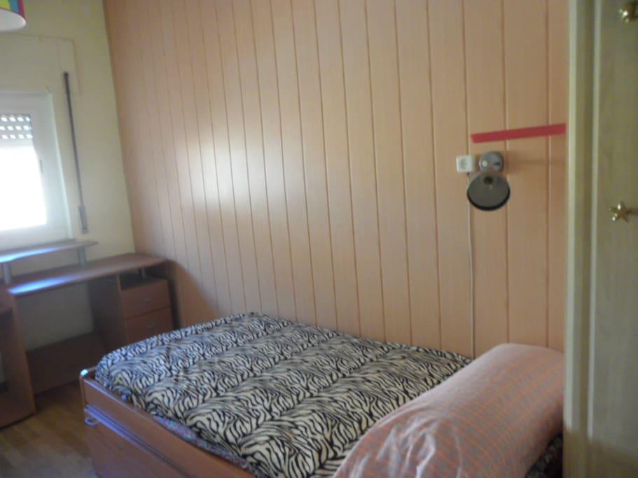 Habitación cama simple