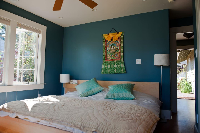 Eastern King bedroom with beautiful morning sun