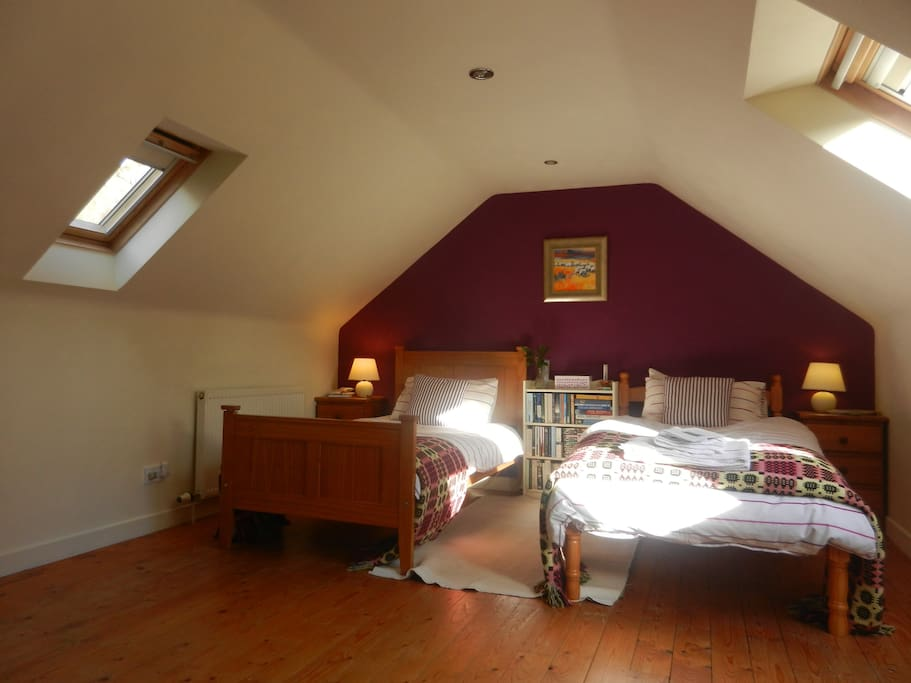 Twin beds nestle under the eaves, with two large velux windows looking to the south and one small one to the north. All have blackout blinds to help you sleep in the long bright summer nights