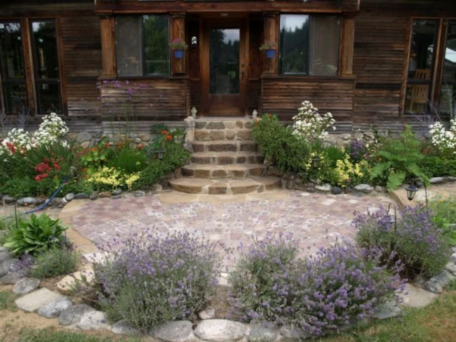 The front entrance surrounded by flower gardens.