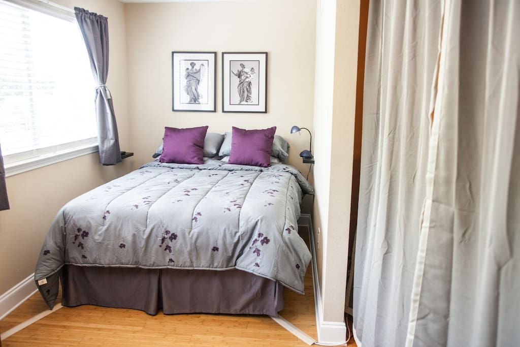 Curtains provide privacy between the bedroom and living room.