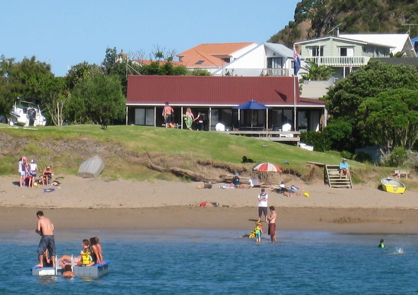 Absolute beachfront on an all tide swimming beach close to attractions. Sleeps 2-13