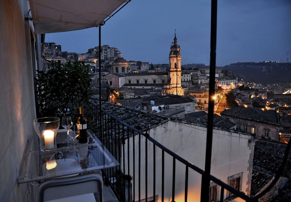 wine tasting in front of the lights of Modica
