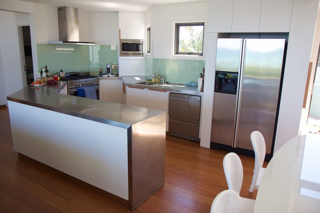 Stainless steel kitchen benchtops with European appliances.