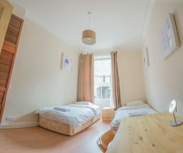 Spacious central room with two beds