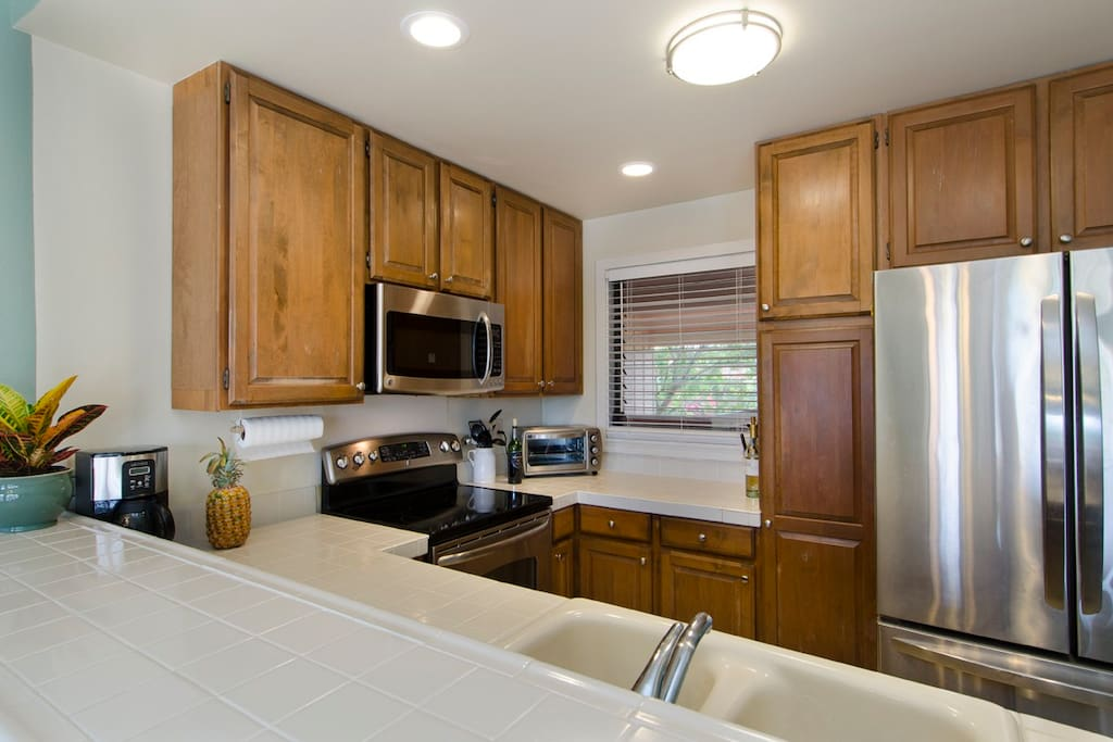Spacious open concept kitchen with upgraded stainless appliances and plenty of storage space.