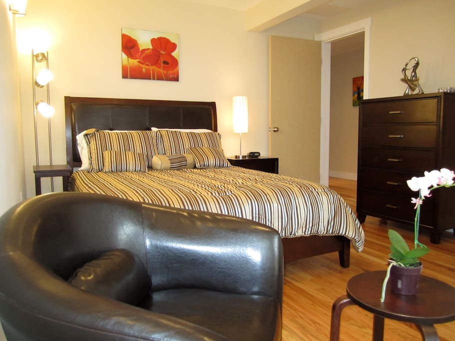 One bedroom suite with sitting chair. Opens to private brick patio.