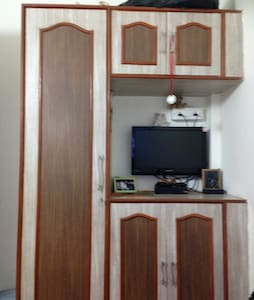 My house is located in the Andheri East. (suburbs of Mumbai).  The room is very well furnished. Comfortable rooms and budget friendly.